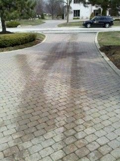 Oil Stained brick paver driveway