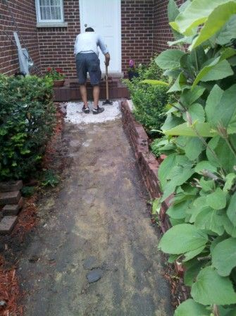 Paver Protector crew repairing a failed settling brick paver walkway in barrington