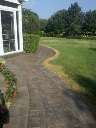 Unilock walkway after being sealed with wet look sealer by Paver Protector Inc.
