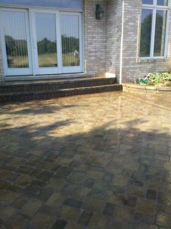 Unilock brick paver patio after being sealed with wet look sealer by Paver Protector Inc.