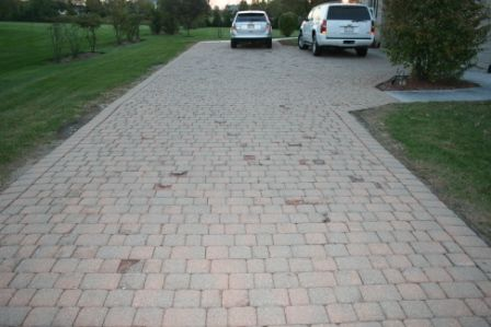 Driveway damaged by rock salt brick pavers PaverProtector.com